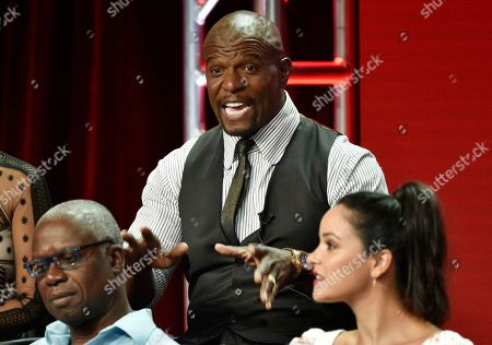 """Terry Crews, Andre Braugher, Melissa Fumero. Terry Crews, center, a cast member in the NBC Universal television series """"Brooklyn Nine-Nine,"""" answers a questino as cast members Andre Braugher, left, and Melissa Fumero look on during the 2018 Television Critics Association Summer Press Tour, in Beverly Hills, Calif"""
