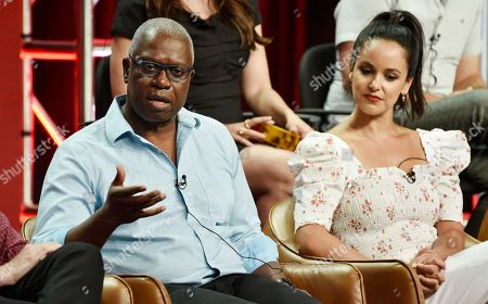 """Andre Braugher, Melissa Fumero. Andre Braugher, left, a cast member in the NBC Universal television series """"Brooklyn Nine-Nine,"""" answers a question as fellow cast member Melissa Fumero looks on during the 2018 Television Critics Association Summer Press Tour, in Beverly Hills, Calif"""