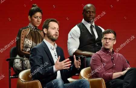 """Dan Goor, Andy Samberg, Terry Crews, Stephanie Beatriz. Dan Goor, second from left, executive producer of the NBC Universal television series """"Brooklyn Nine-Nine,"""" answers a question as cast members, from left, Stephanie Beatriz, Terry Crews and Andy Samberg look on during the 2018 Television Critics Association Summer Press Tour, in Beverly Hills, Calif"""