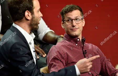 """Dan Goor, Andy Samberg. Brooklyn Nine-Nine"""" cast member Andy Samberg, right, looks on as the show's executive producer Dan Goor makes a point during the 2018 Television Critics Association Summer Press Tour, in Beverly Hills, Calif"""
