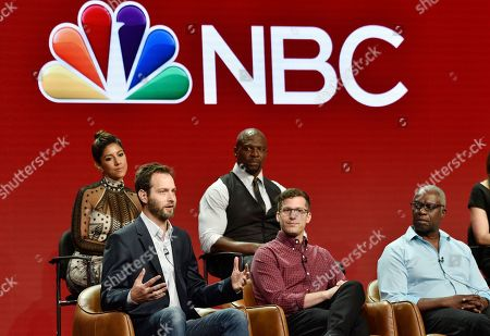 """Dan Goor, Stephanie Beatriz, Terry Crews, Andy Samberg, Andrea Braugher. Dan Goor, bottom left, executive producer of the NBC Universal television series """"Brooklyn Nine-Nine,"""" answers a question as cast members, from left, Stephanie Beatriz, Terry Crews, Andy Samberg and Andre Braugher look on during the 2018 Television Critics Association Summer Press Tour, in Beverly Hills, Calif. The series was picked up by NBC Universal after being cancelled this year by FOX"""