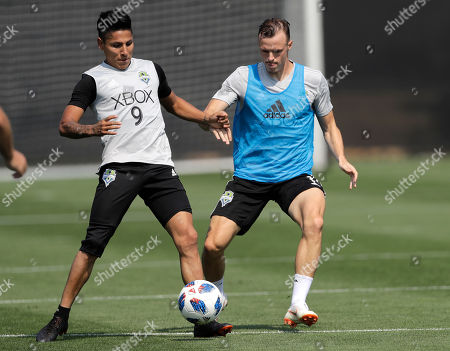 Seattle Sounders defender Brad Smith, right, challenges forward Raul Ruidiaz (9) during MLS soccer training, in Tukwila, Wash. The Sounders acquired Smith, who is from Australia, on loan from English Premier League club Bournemouth in a deal announced Wednesday