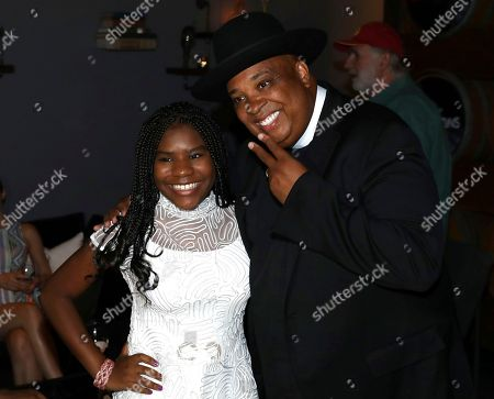 Trinitee Stokes, Joseph Simmons. Trinitee Stokes, left, and Joseph Simmons are seen at Netflix's All About the Washingtons Premiere Party at Madera Kitchen on in Los Angeles
