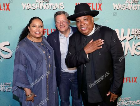 Justine Simmons, Ted Sarandos, Joseph Simmons. Justine Simmons, from left, Ted Sarandos, chief content officer for Netflix, and Joseph Simmons are seen at Netflix's All About the Washingtons Premiere Party at Madera Kitchen on in Los Angeles