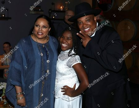 Justine Simmons, Trinitee Stokes, Joseph Simmons. Justine Simmons, from left, Trinitee Stokes and Joseph Simmons are seen at Netflix's All About the Washingtons Premiere Party at Madera Kitchen on in Los Angeles