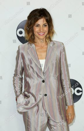Stephanie Szostak arrives at the Disney/ABC 2018 Television Critics Association Summer Press Tour at the Beverly Hilton, in Beverly Hills, Calif