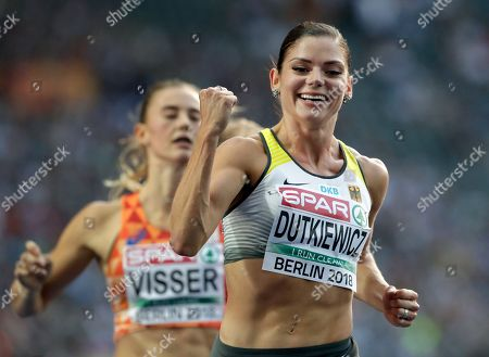 Germany's Pamela Dutkiewicz, front, celebrates after a woman's 100 meter hurdles semi final at the European Athletics Championships in Berlin, Germany