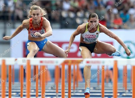 Netherlands' Nadine Visser, left, and Germany's Pamela Dutkiewicz, right, compete during a woman's 100 meter hurdles semi final at the European Athletics Championships in Berlin, Germany