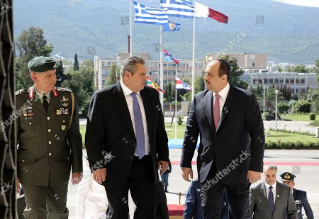 Greek National Defense Minister Panos Kammenos (2-L) welcomes Qatar's Minister of State for Defense Affairs Khalid bin Mohammed Al Attiyah (R) during a meeting at the Defense Ministry in Athens, Greece, 09 August 2018. Others are not identified.