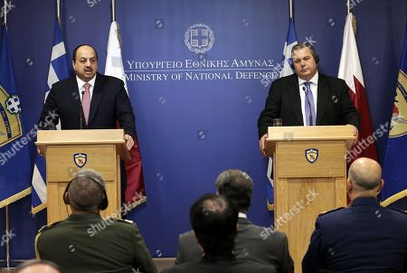 Greek National Defense Minister Panos Kammenos (R) and Qatar's Minister of State for Defense Affairs Khalid bin Mohammed Al Attiyah (L) attend a press conference after a meeting at the Defense Ministry in Athens, Greece, 09 August 2018.