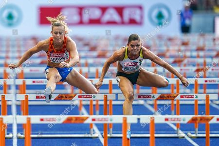 Nadine Visser of Netherlands and Pamela Dutkiewicz of Germany during 100 meter hurdles semifinal for women at the Olympic Stadium in Berlin at the European Athletics Championship