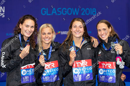 Denmark's (L-R) Mie OE. Nielsen, Pernille Blume, Emilie Beckmann, and Rikke Moeller Pedersen pose with their silver medals on the podium of the women's 4x100m Medley Relay final at the Glasgow 2018 European Swimming Championships in Glasgow, Britain, 09 August 2018.