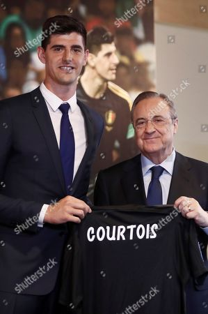 Real Madrid's president Florentino Fernandez (R) poses next to Belgian Thibaut Courtois (L) during his presentation as Real Madrid's new goalkeeper at Santiago Bernabeu stadium in Madrid, Spain, 09 August 2018.