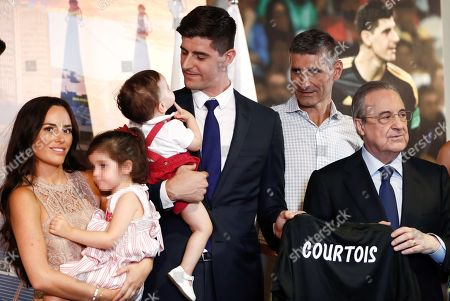 Stock Picture of Real Madrid's president, Florentino Fernandez (R), poses next to Belgian Thibaut Courtois (3R), his wife, Marta Dominguez (L), his children and his father, Thierry Courtois (2R), during his presentation as Real Madrid's new goalkeeper at Santiago Bernabeu stadium in Madrid, Spain, 09 August 2018. (Editors note: Face of minor blurred by source in accordance with Spanish law)