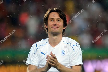 Former Arsenal midfielder Tomas Rosicky officially ends his professional playing career at the friendly soccer match at Letna Stadium.