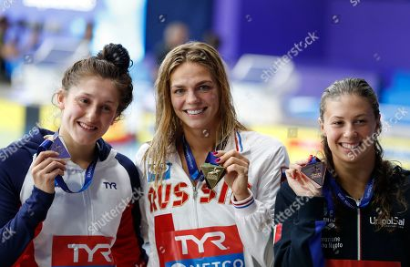 Stock Image of Silver medalist Imogen Clark of Great Britain, left, gold medalist Yuliya Efimova of Russia, bronze medalist Arianna Castiglioni of Italy pose on the podium of the 50 meters breaststroke women final at the European Swimming Championships in Glasgow, Scotland