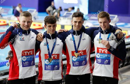 From left, Adam Peaty, Nicholas Pyle, James Guy, Duncan W Scott, of Great Britain, pose with their gold medals won 4 X 100 meters medley relay men final at the European Swimming Championships in Glasgow, Scotland