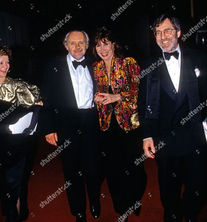 Jennifer Lynton and her husband Anthony Hopkins along with Michelle Lee and her husband Fred Rappoport arrive in the lobby of the Kennedy Center to attend the annual Kennedy Center Honors awards ceremony