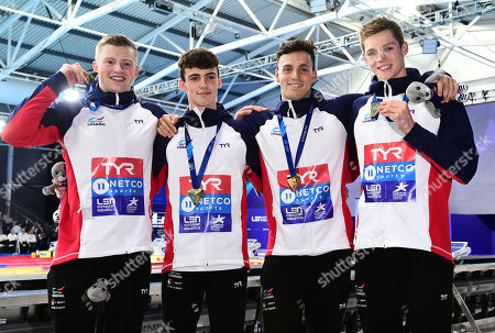 Adam Peaty, Nicholas Pyle, James Guy and Duncan Scott of Great Britain pose with their gold medals after winning the Men's 4x100m Medley Relay.