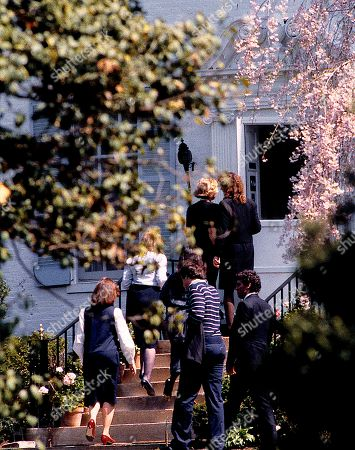 "Members of the Kennedy famiy walk up the stairs to ""Hickory Hill"" the Kennedy famiky estate in McLean Viriginia awaiting the arrival of the hearse bearing the body of their cousin, David Kennedy who died of a drug overdose in Florida two days before."