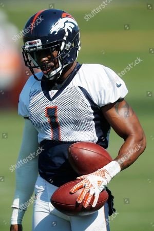 Marquette King, r m. Denver Broncos punter Marquette King takes part in drills at NFL football training camp, in Englewood, Colo