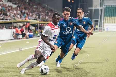 Sofyan Amrabat (R) and Calvin Verdonk (C) of Feyenoord Rotterdam and Osman Bukari (L) of AS Trencin in action during the UEFA Europa League third qualifying round first leg soccer match between AS Trencin and Feyenoord Rotterdam in Zilina, Slovakia, 09 August 2018.