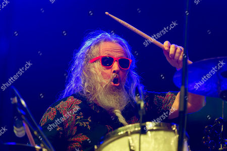 Stock Image of Dan Magnusson, drummer of American blues musician Seasick Steve performs live on the second day of the 26th Sziget (Island) Festival on Shipyard Island, northern Budapest, Hungary, 09 August 2018. The Sziget Festival is one of the biggest cultural events of Europe offering art exhibitions, theatrical and circus performances and above all music concerts.
