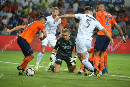 Burnley's James Tarkowski, no 5, tries to gain the ball as Istanbul Basaksehir's Mahmut Tekdemir, left, goalkeeper Mert Gunok, centre and Manuel da Costa right, try to stop himvduring the Europa League qualification soccer match between Istanbul Basaksehir and Burnley, at the Fatih Terim stadium in Istanbul