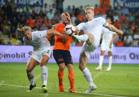 Stock Picture of Burnley's Charlie Taylor, left and Benjamin Mee, right, try to block Istanbul Basaksehir's Edin Visca, during the Europa League qualification soccer match between Istanbul Basaksehir and Burnley, at the Fatih Terim stadium in Istanbul