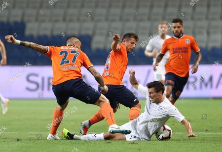 Basaksehir's Manuel Da Costa (L) and Emre Bolezoglu (C) in action against Burnley's Jack Cork (R) during the UEFA Europe League third qualifying round first leg soccer match between Basaksehir Istanbul and Burnley FC at Fatih Terim stadium in Istanbul, Turkey, 09 August 2018.