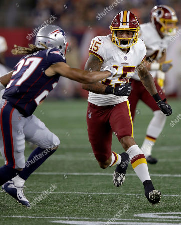 New England Patriots defensive back Ryan Lewis (27) defends against Washington Redskins wide receiver Simmie Cobbs (15) during the first half of a preseason NFL football game, in Foxborough, Mass