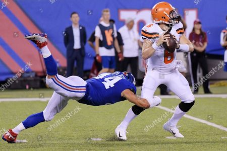 Stock Picture of Baker Mayfield, Mark Herzlich. New York Giants linebacker Mark Herzlich (44) dives for Cleveland Browns quarterback Baker Mayfield (6) during the first half of a preseason NFL football game, in East Rutherford, N.J