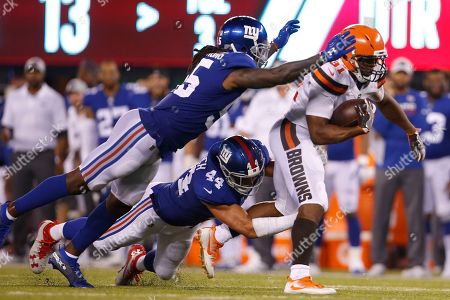 Cleveland Browns running back Nick Chubb (31) rushes past New York Giants' Mark Herzlich (44) during the second half of a preseason NFL football game, in East Rutherford, N.J