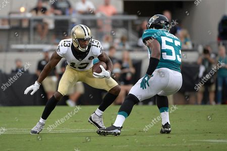 New Orleans Saints wide receiver Michael Thomas (13) runs after catching a pass in front of Jacksonville Jaguars linebacker Blair Brown (53) during the first half of an NFL preseason football game, in Jacksonville, Fla