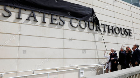Stock Picture of Thad Cochran, Kay Webber. Former U.S. Sen. Thad Cochran, left, and his wife Kay Webber pull at the rope to unveil Cochran's name during the naming ceremony of the Thad Cochran United States Courthouse in downtown Jackson, Miss., . Unfortunately, the rope broke and the veil had to be removed by workmen later in the day