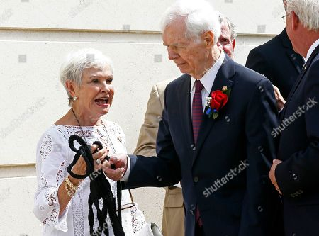 Stock Photo of Thad Cochran, Kay Webber. Former U.S. Sen. Thad Cochran, second from left, and his wife Kay Webber, react at the ripped rope attached to the veil over Cochran's name during the unveiling prior to the naming ceremony of the Thad Cochran United States Courthouse in downtown Jackson, Miss., . The rope broke and the veil had to be removed by workmen later in the day