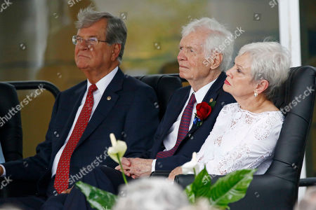 Stock Image of Thad Cochran, Trent Lott, Kay Webber. Former Republican U.S. Sens. Trent Lott, left, and Thad Cochran, seated next to his wife, Kay Webber, listen to remarks from speakers during the naming ceremony of the Thad Cochran United States Courthouse in downtown Jackson, Miss