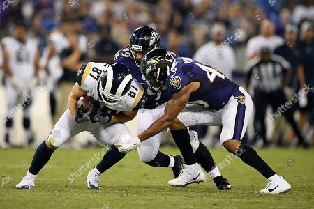 Stock Picture of Week 13. Los Angeles Rams tight end Henry Krieger-Coble, left, is tackled by Baltimore Ravens linebackers Kenny Young, front right, and Chris Board in the second half of a preseason NFL football game, in Baltimore