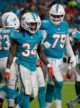 Senorise Perry, Sam Young. Miami Dolphins running back Senorise Perry (34) walks back to the bench after scoring a touchdown, during the first half of an NFL preseason football game against the Tampa Bay Buccaneers, in Miami Gardens, Fla.To the right is Miami Dolphins offensive tackle Sam Young (79
