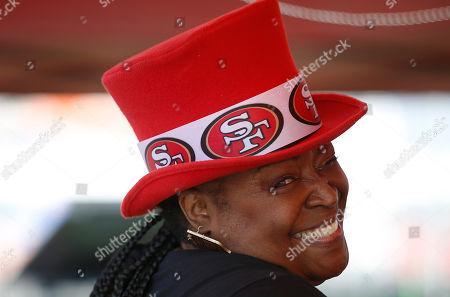 San Francisco 49ers fan Debbie Ryan tailgates before an NFL preseason football game between the 49ers and the Dallas Cowboys in Santa Clara, Calif