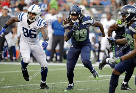 Seattle Seahawks linebacker Shaquem Griffin (49) runs next to Indianapolis Colts tight end Erik Swoope (86) during the first half of an NFL football preseason game, in Seattle