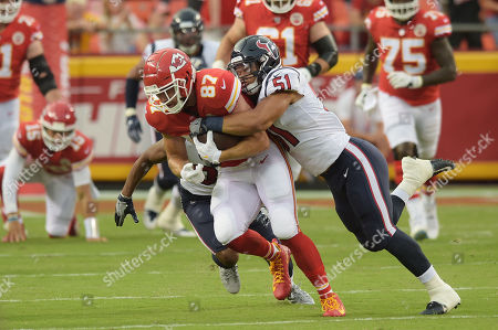 Kansas City Chiefs tight end Travis Kelce (87) can't escape the tackle made by Houston Texans linebacker Dylan Cole (51) during the NFL Pre-Season Football Game between the Houston Texans and the Kansas City Chiefs at Arrowhead Stadium in Kansas City, Missouri