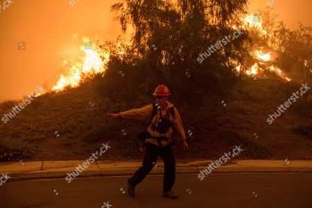 As the wind picks up the fire spreads closer to the Horsethief Community. Cal Fire firefighters burn brush near the houses.  Evacuations were ordered near a 9,600-acre wildfire that raced through dry brush in Cleveland National Forest and spread toward homes.