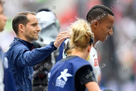 France's Renaud Lavillenie comforts Germany's Raphael Holzdeppe who didn't set a mark in the men's pole vault qualification at the European Athletics Championships at the Olympic stadium in Berlin, Germany