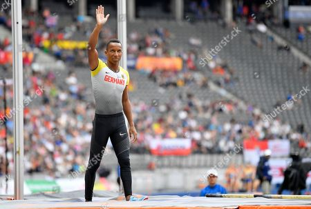 Germany's Raphael Holzdeppe who didn't set a mark waves in the men's pole vault qualification at the European Athletics Championships at the Olympic stadium in Berlin, Germany