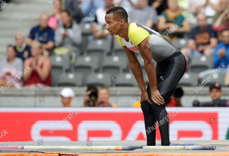 Germany's Raphael Holzdeppe stands on the mat after he didn't set a mark in the men's pole vault qualification at the European Athletics Championships at the Olympic stadium in Berlin, Germany