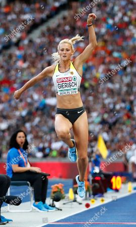 Germany's Kristin Gierisch makes an attempt in the women's triple jump final at the European Athletics Championships at the Olympic stadium in Berlin, Germany