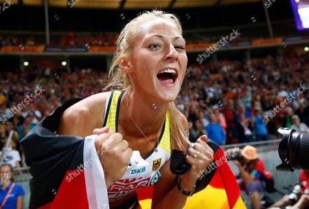 Germany's Kristin Gierisch celebrates after winning the silver medal in the women's triple jump final at the European Athletics Championships at the Olympic stadium in Berlin, Germany