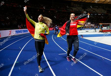 Germany's triple jump silver medal winner Kristin Gierisch, left, and Germany's javelin gold medal winner Christin Hussong celebrate at the European Athletics Championships at the Olympic stadium in Berlin, Germany