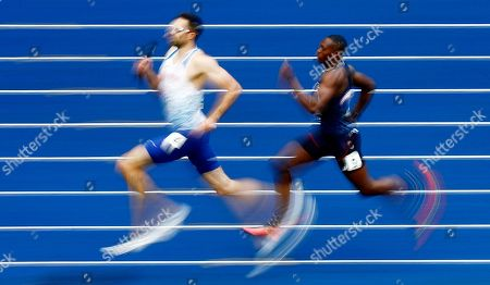 Stock Image of Martyn Rooney (L) of Great Britain and Thomas Jordier of France compete in Heat 1 of the men's 4x400m Relay heats at the Athletics 2018 European Championships, Berlin, Germany, 10 August 2018.